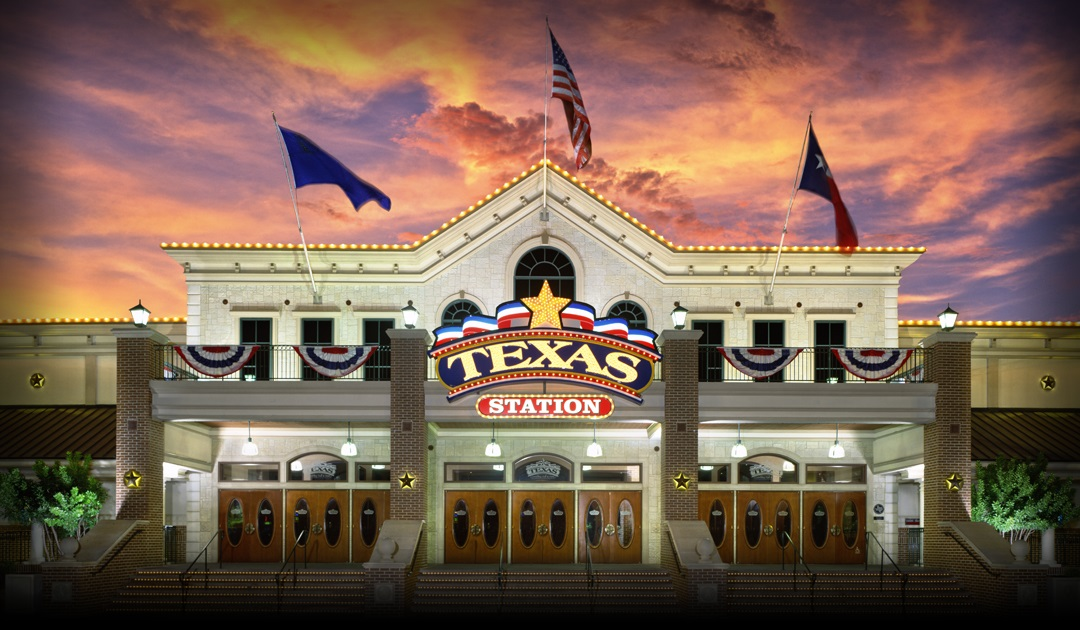 Front view of Texas Station exterior with colorful sunset in background