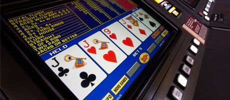 Video poker terminal showing four-of-a-kind Jacks with a 9 of hearts